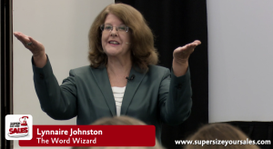 Photo of Lynnaire Johnston, the Word Wizard, training staff.